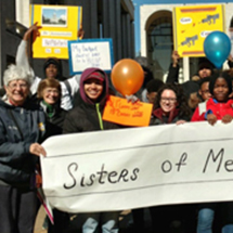 image of Sr. Betty Calfapietra with Cristo Rey High School students at march in NYC