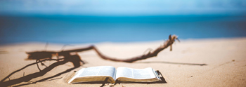 image of beach and opened book