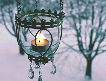 image of candle lighting winter darkness