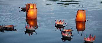 image of candles on water