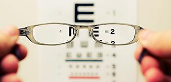 image of eyeglasses and eye chart